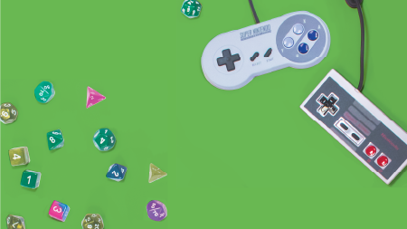 gaming controllers and game pieces on a green background
