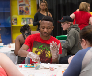 Image of student at a cookie decorating station.