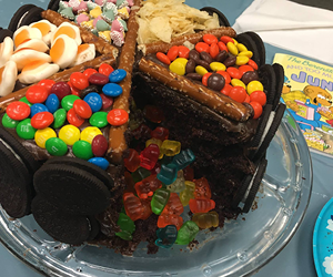 "Image of final live demo entry for Berenstain Bears ""Too Much Junk Food,"" a cake covered in junk food."