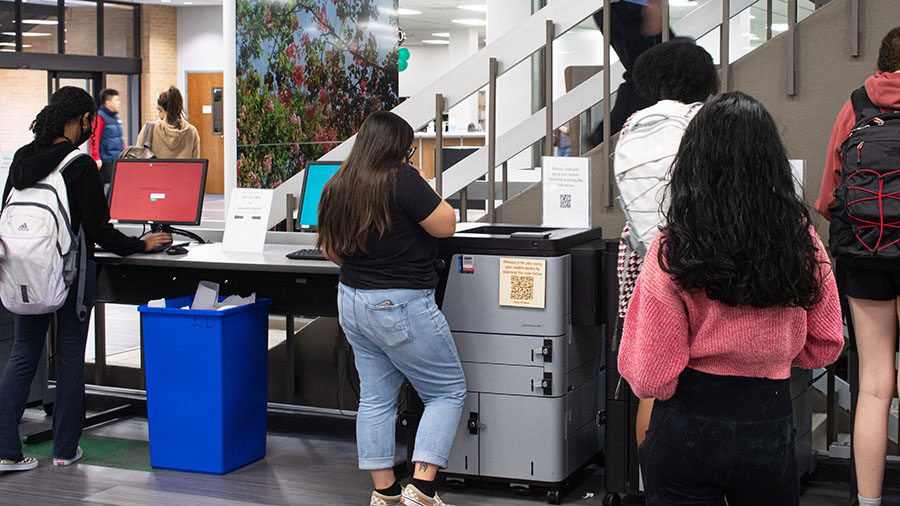 two students at a printer