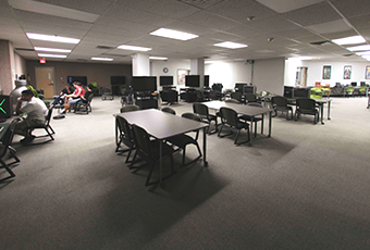gaming commons area with tables and chairs