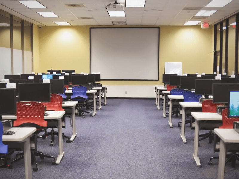 computer classroom with computer stations and presentation screen