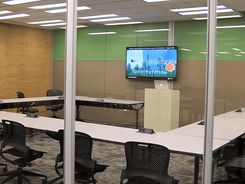 study room with tables, chairs, TV screen