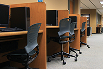 computer workstations with chairs