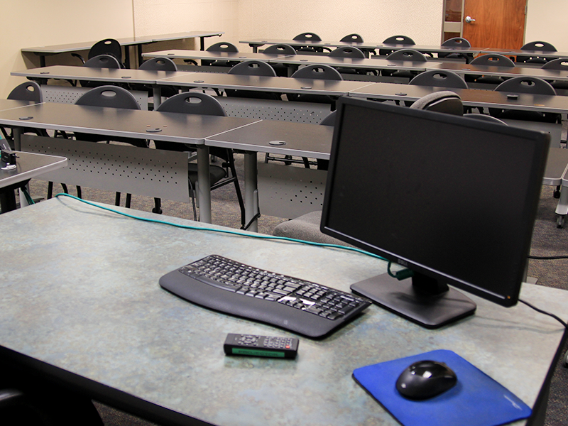classroom with computers and chairs