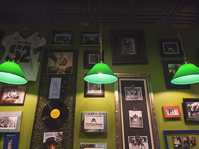green lights in front of framed memorabilia