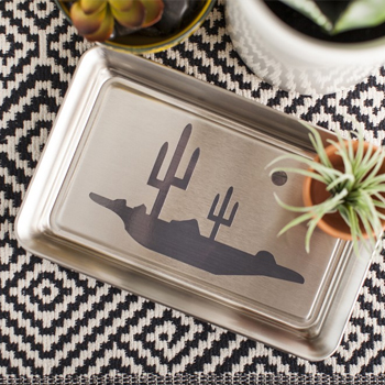 die cut design on a silver tray