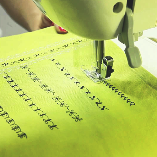 machine sewing stitches into fabric