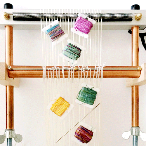 spools of thread on a loom