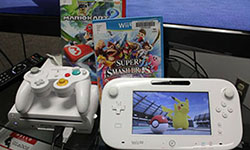 Photo of Wii U console and games.
