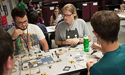 Photo of students playing a tabletop game.